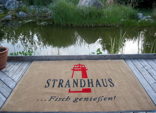 Stickmatte Strandhaus